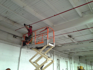 St. Louis contractor on lift in the middle of a Missouri fire sprinkler system installation