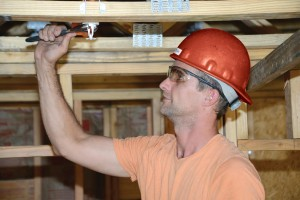 Bryan repairing a fire sprinkler in St. Louis